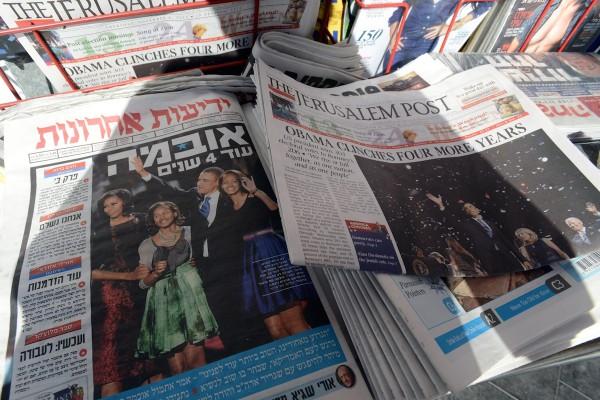 Zavedené izraelské tituly prý rozdáváním deníků grátis trpí. Foto: Profimedia.cz